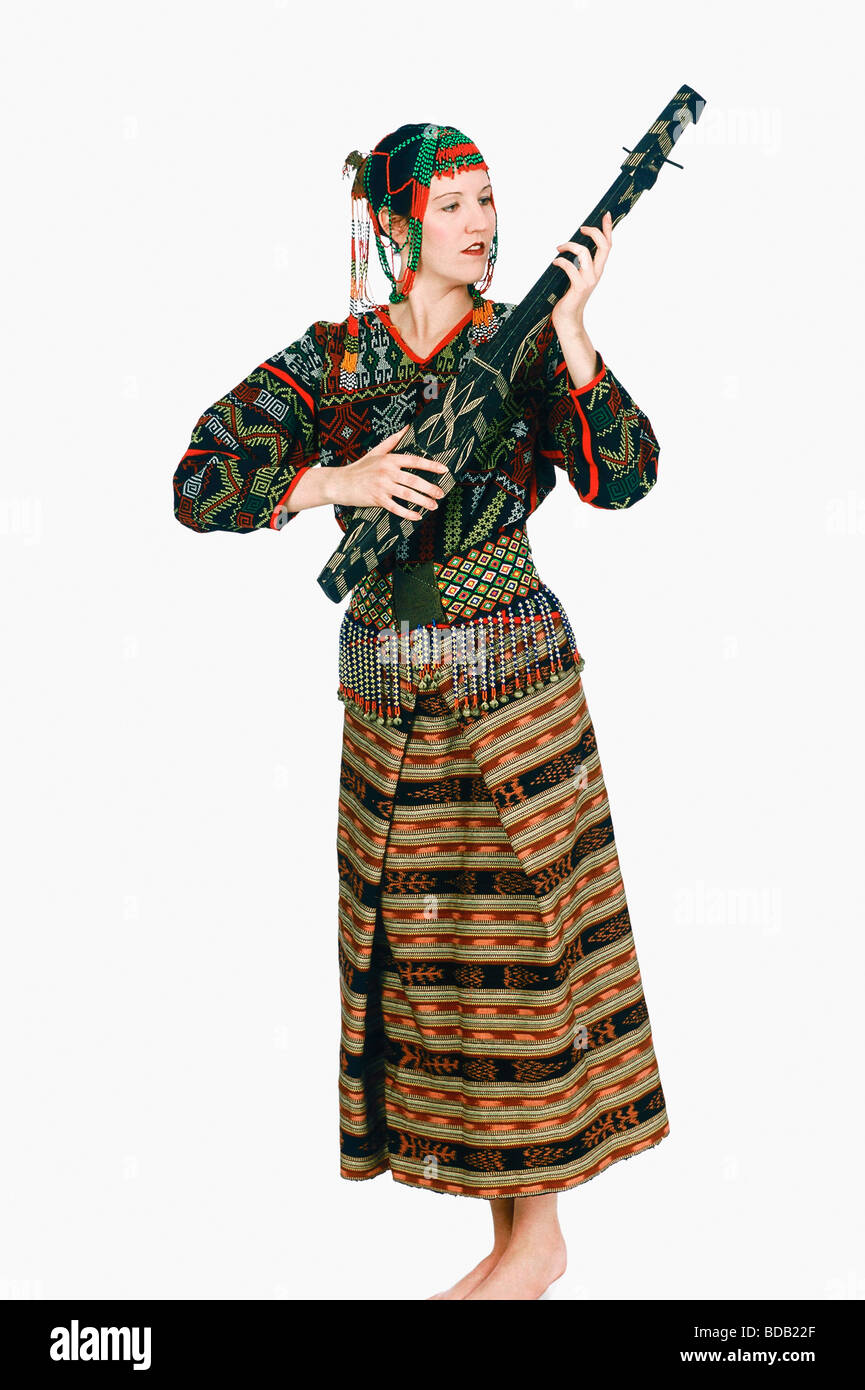 Mature woman playing a stringed instrument - Stock Image