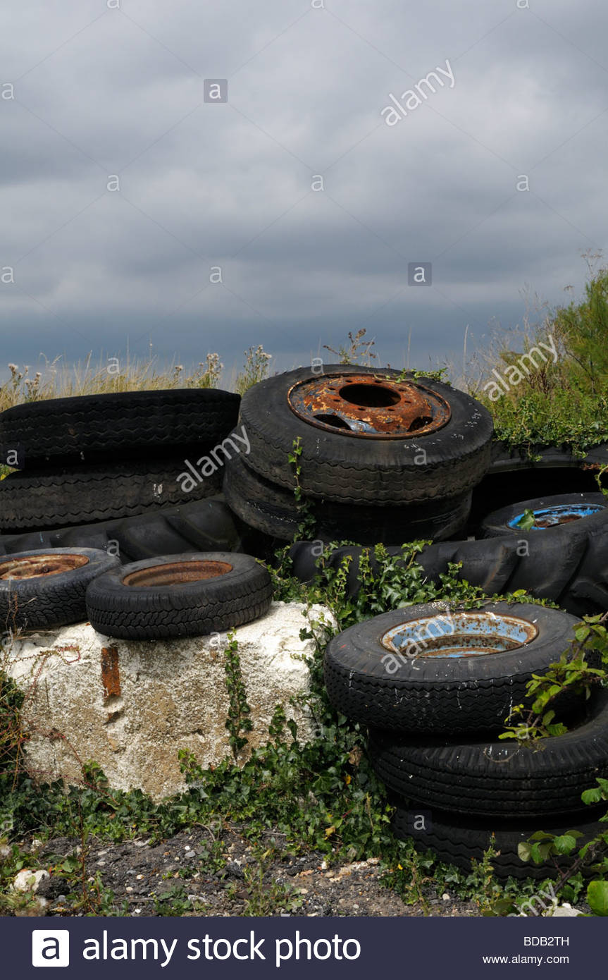 Close up view of dumped tyres on public land, England, UK - Stock Image