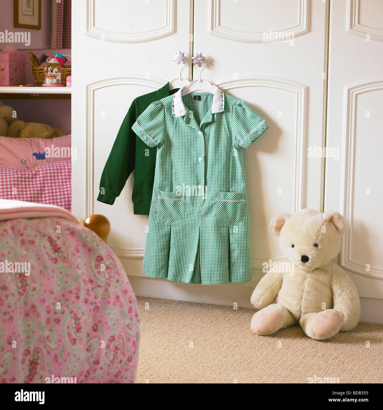 School Uniform ready for wear in a girls bedroom. Stock Photo