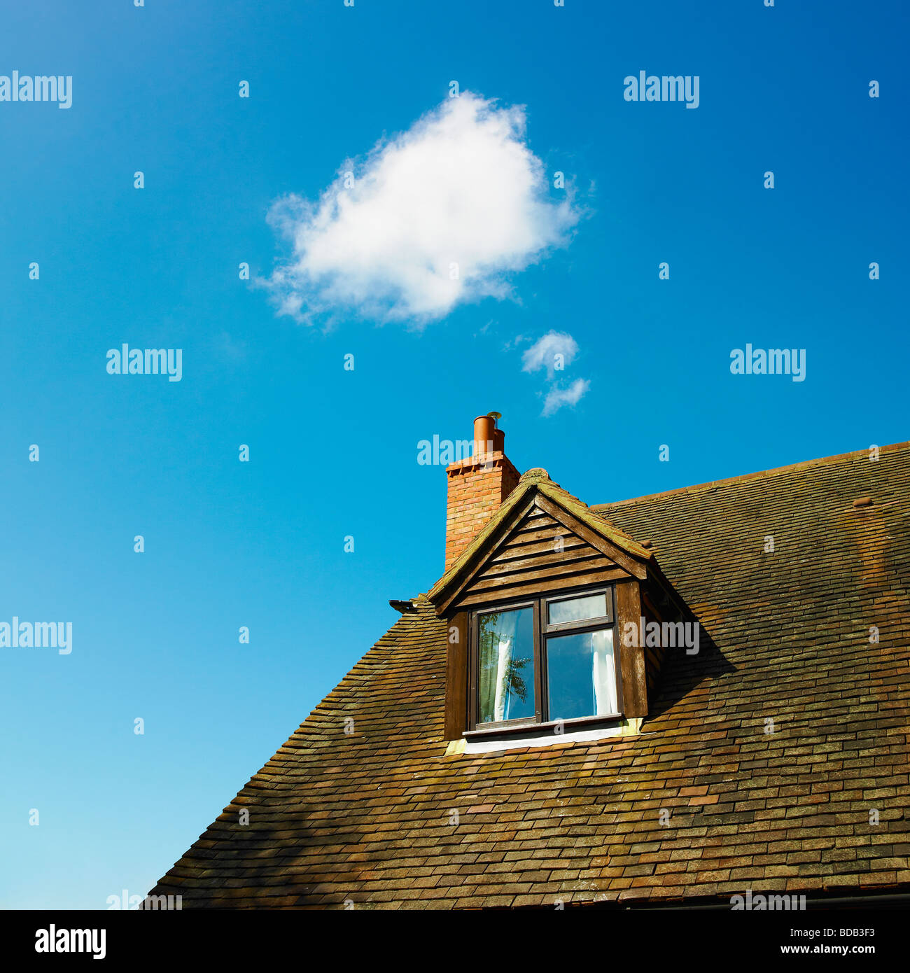 House with cloud and blue sky - cloud computing - home office. - Stock Image