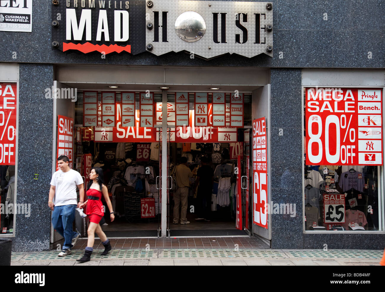 large windows for sale large bow sale signs in shop windows offer large reductions off retail goods on oxford street central london busy shopping area