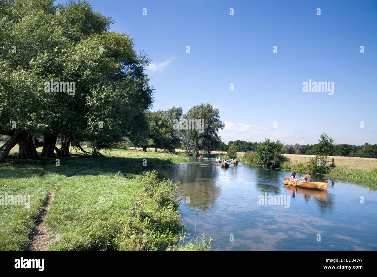 people Boating on the river Stour between The historic village of Dedham and Flatford in Constable country Stock Photo