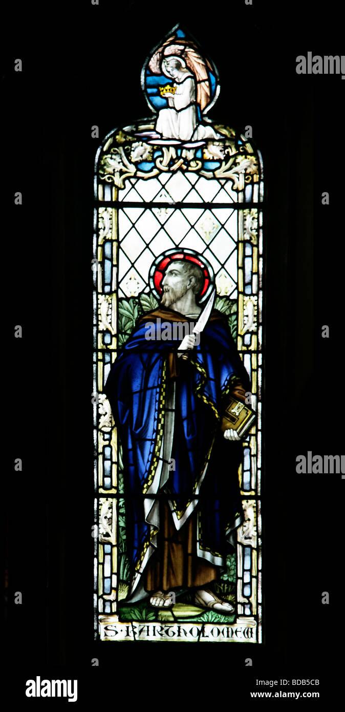 Stained Glass Window Depicting Saint Bartholomew the Apostle Earls Barton Church Northamptonshire - Stock Image