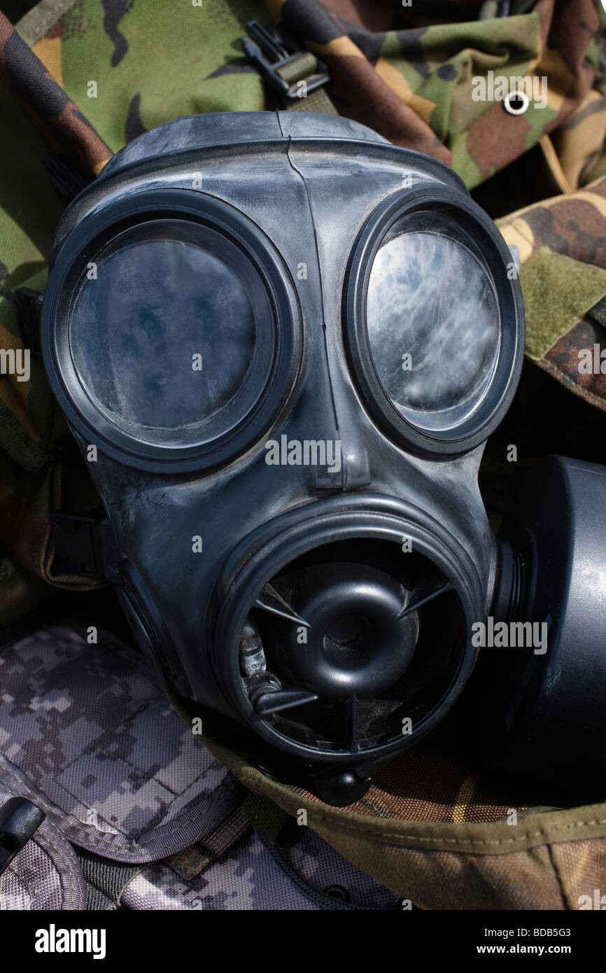 British military gas mask lying on army clothing, on sale at a stall, Ayr, Ayrshire, Scotland, UK, Great Britain - Stock Image