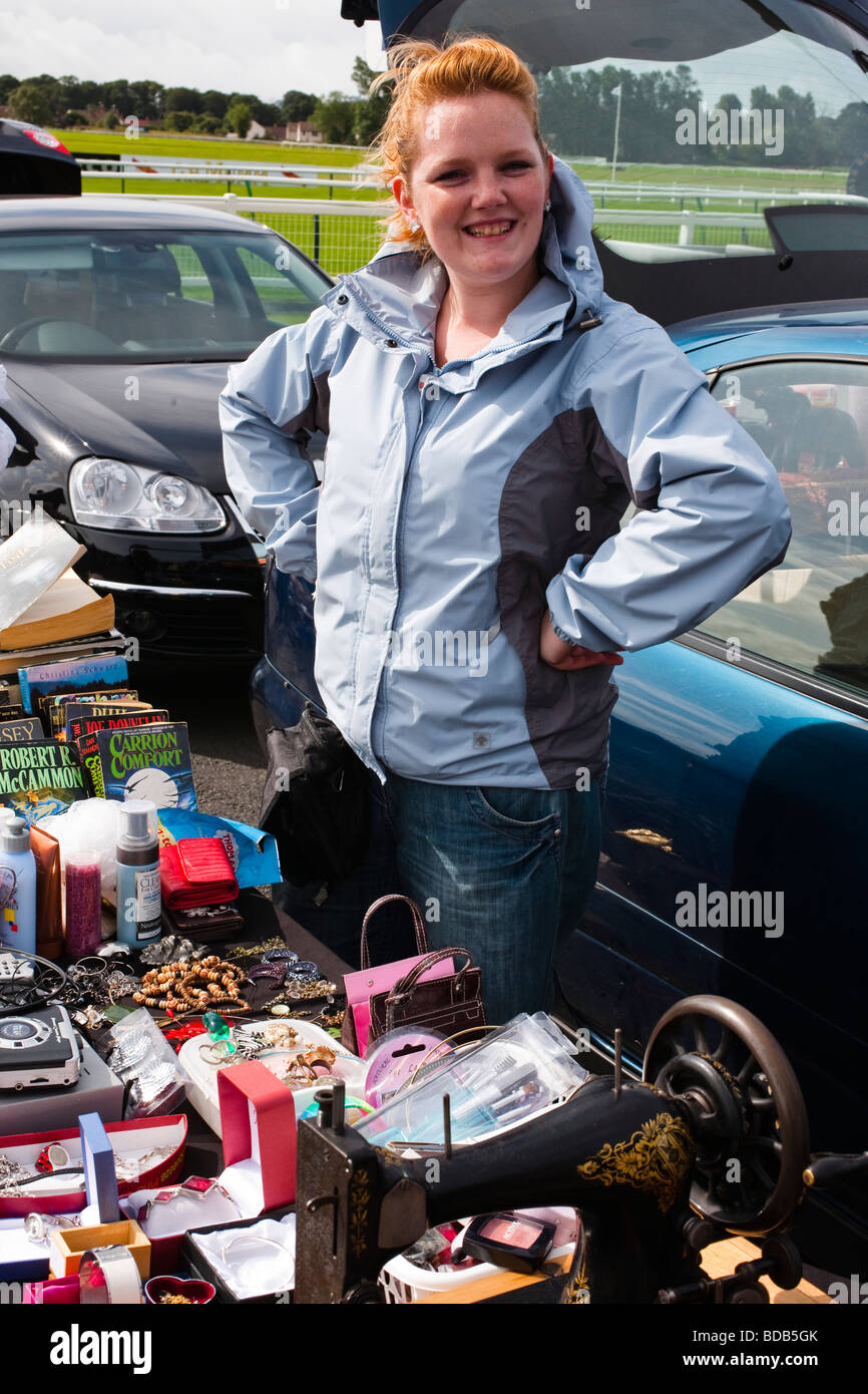 Woman at car boot sale selling second hand goods from a stall, Ayr, Ayrshire, Scotland, UK, Great Britain - Stock Image