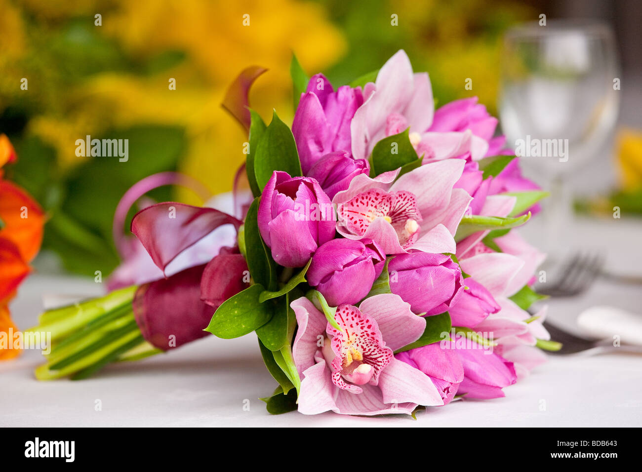 Wedding flowers in a bouquet made up of tulips and orchids stock wedding flowers in a bouquet made up of tulips and orchids izmirmasajfo