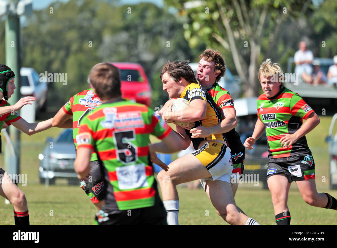 Teams of Australian rugby league playing a match showing the elements of a scrum running kicking and tackle - Stock Image