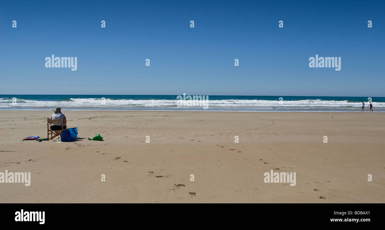 Australian Seascape with one person enjoying the deserted beach - Stock Image