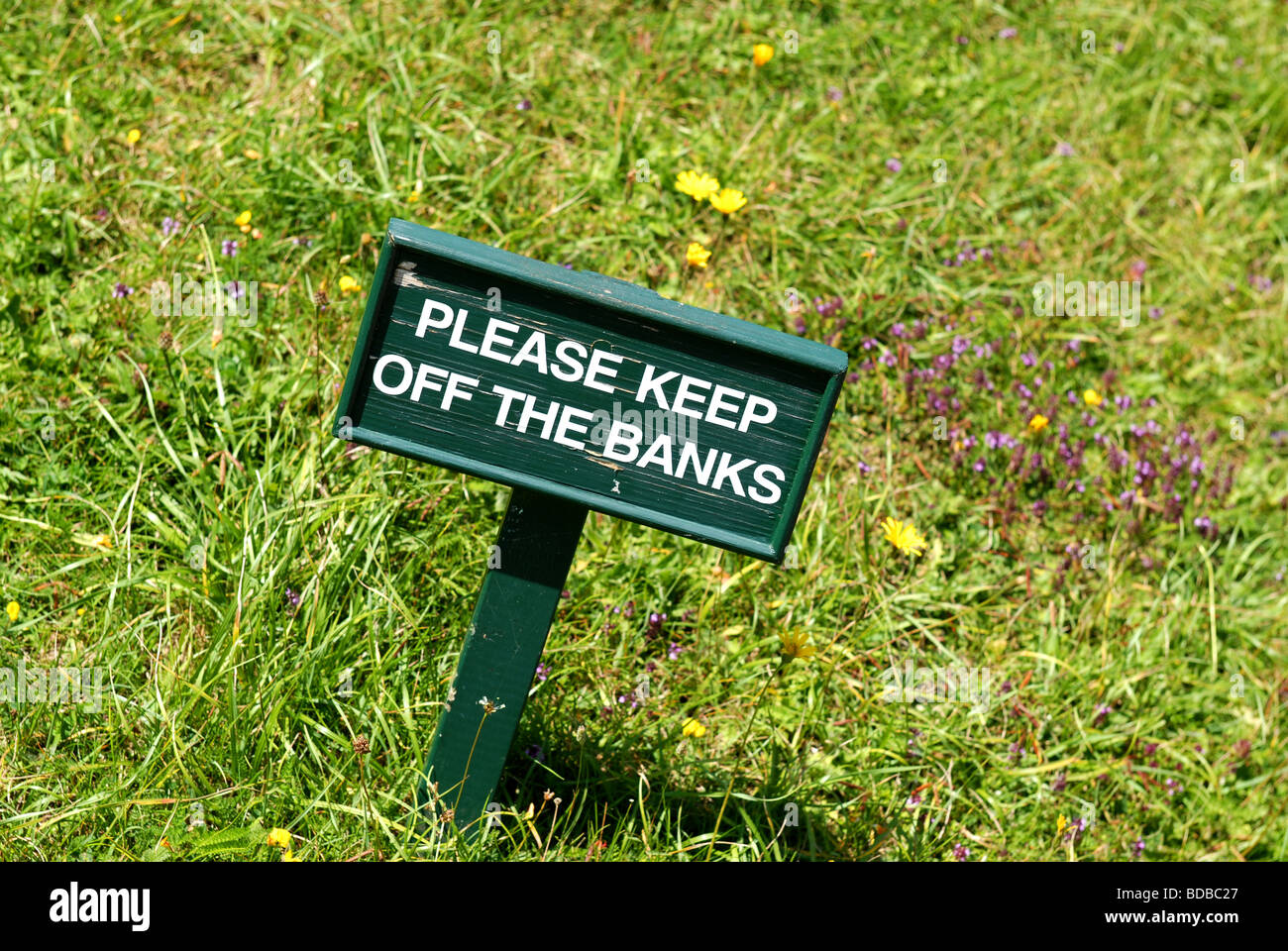 a message intended for visitors to this garden however it could just as easily refer to our financial institutions - Stock Image