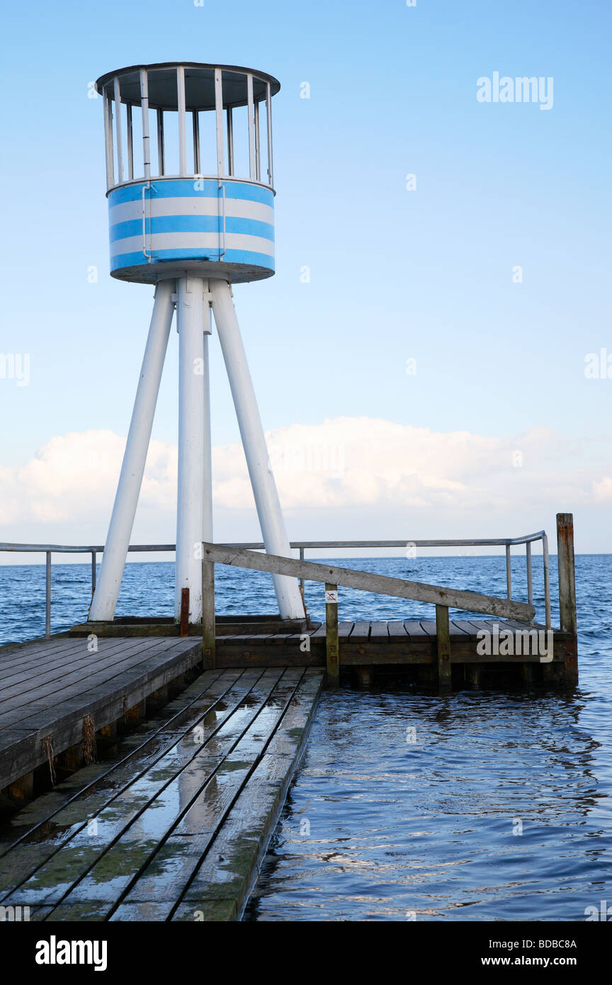 Lifeguard station designed by Arne Jacobsen at the Bellevue Beach resort near Copenhagen in Denmark on a cold day - Stock Image