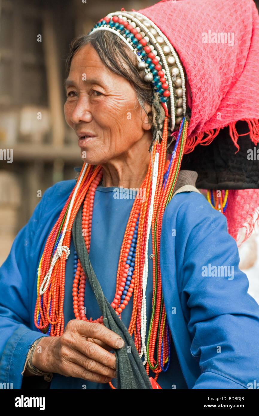 Akha Tribal woman at Xiding market, Yunnan, China - Stock Image