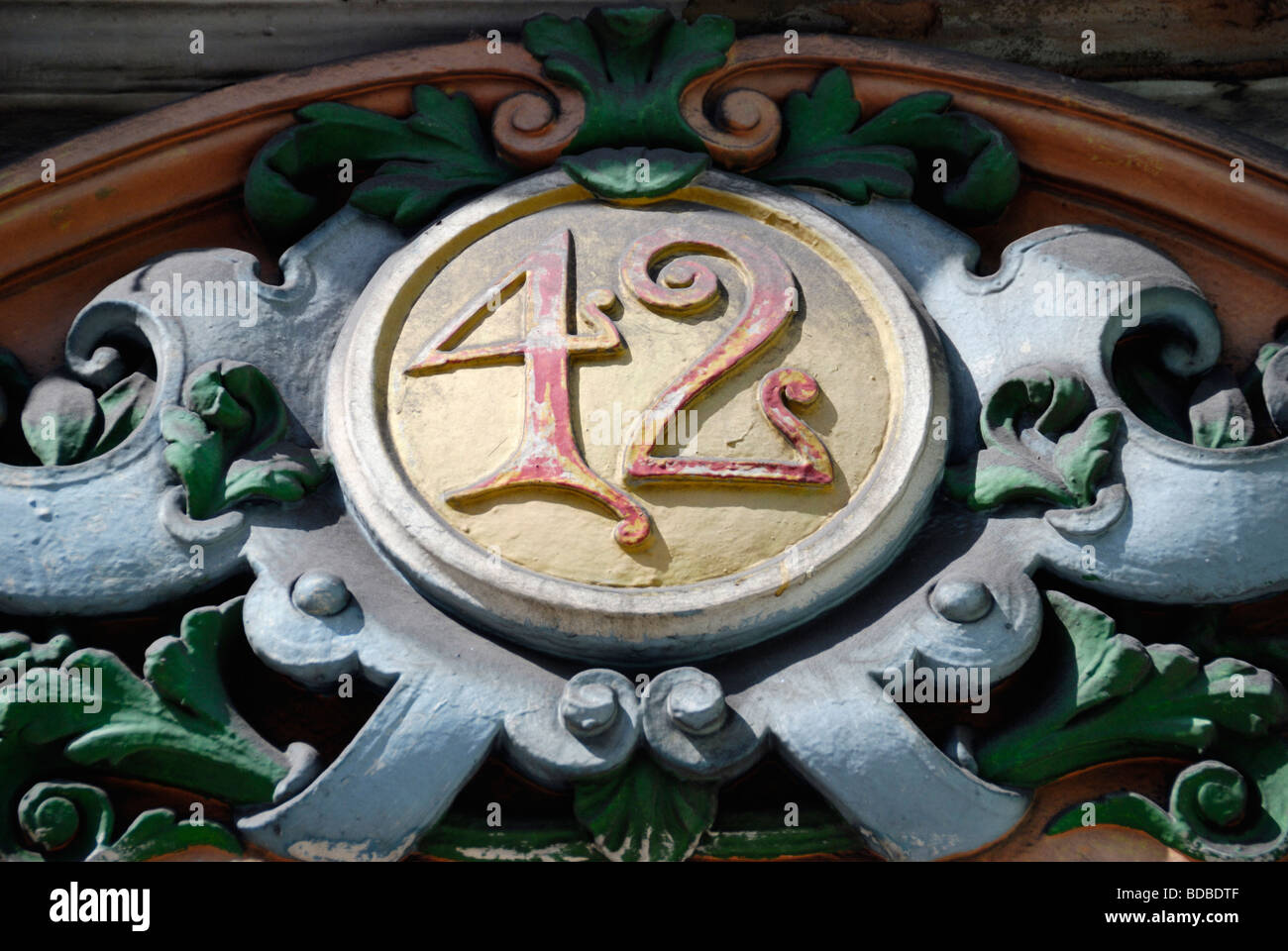 Close up of decorative no 42 street number above entrance to Victorian building London England - Stock Image