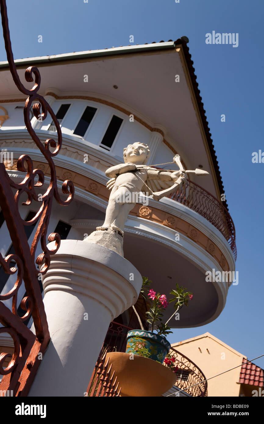 Indonesia Sulawesi Makassar Jalan Baumasepe cupid figure on top of wedding shop gatepost - Stock Image