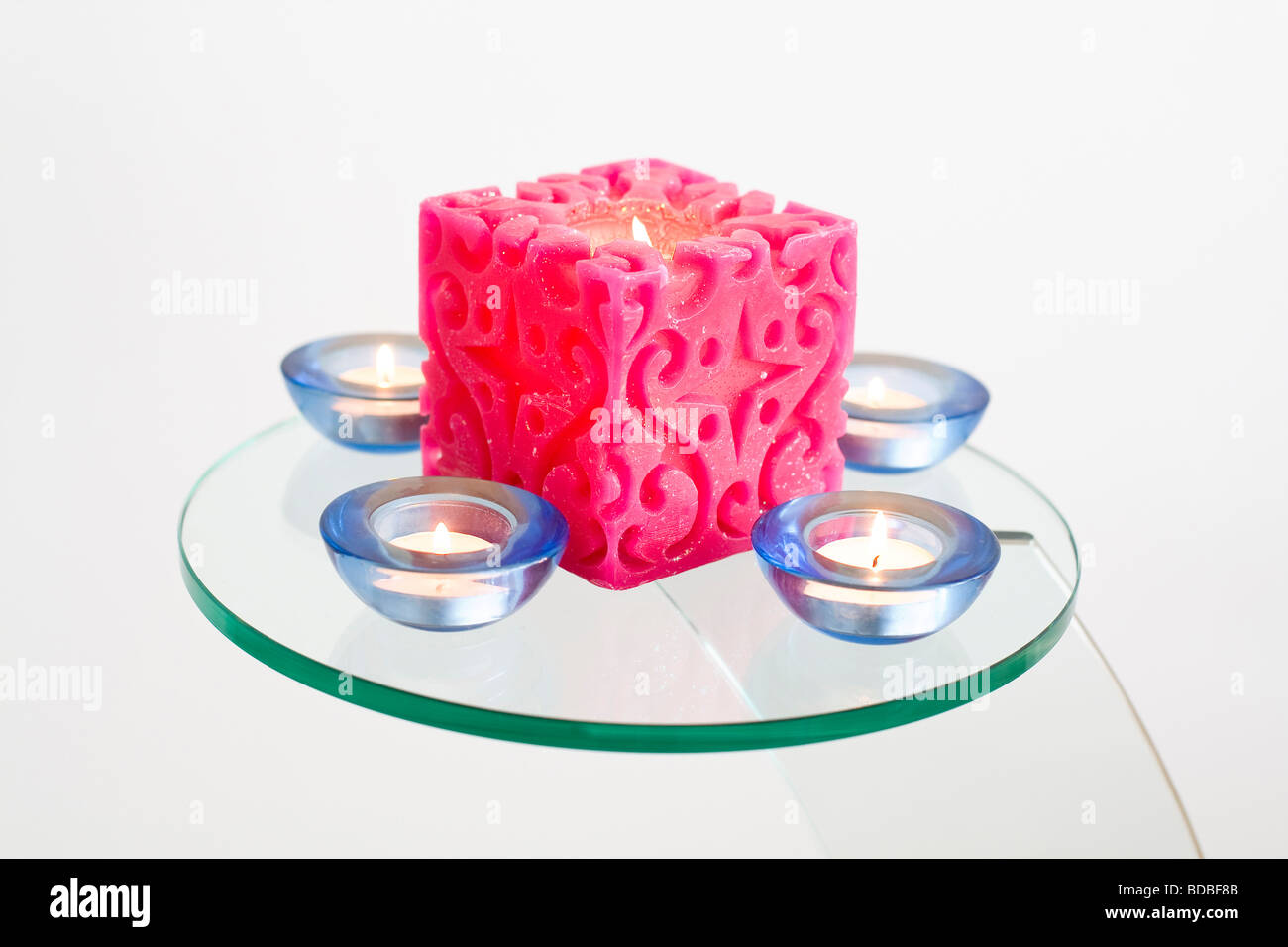 Diwali Candles on Glass Table - Stock Image