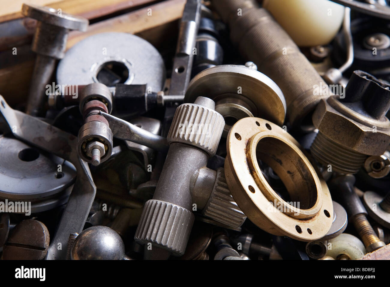 different metal parts in workshop - Stock Image