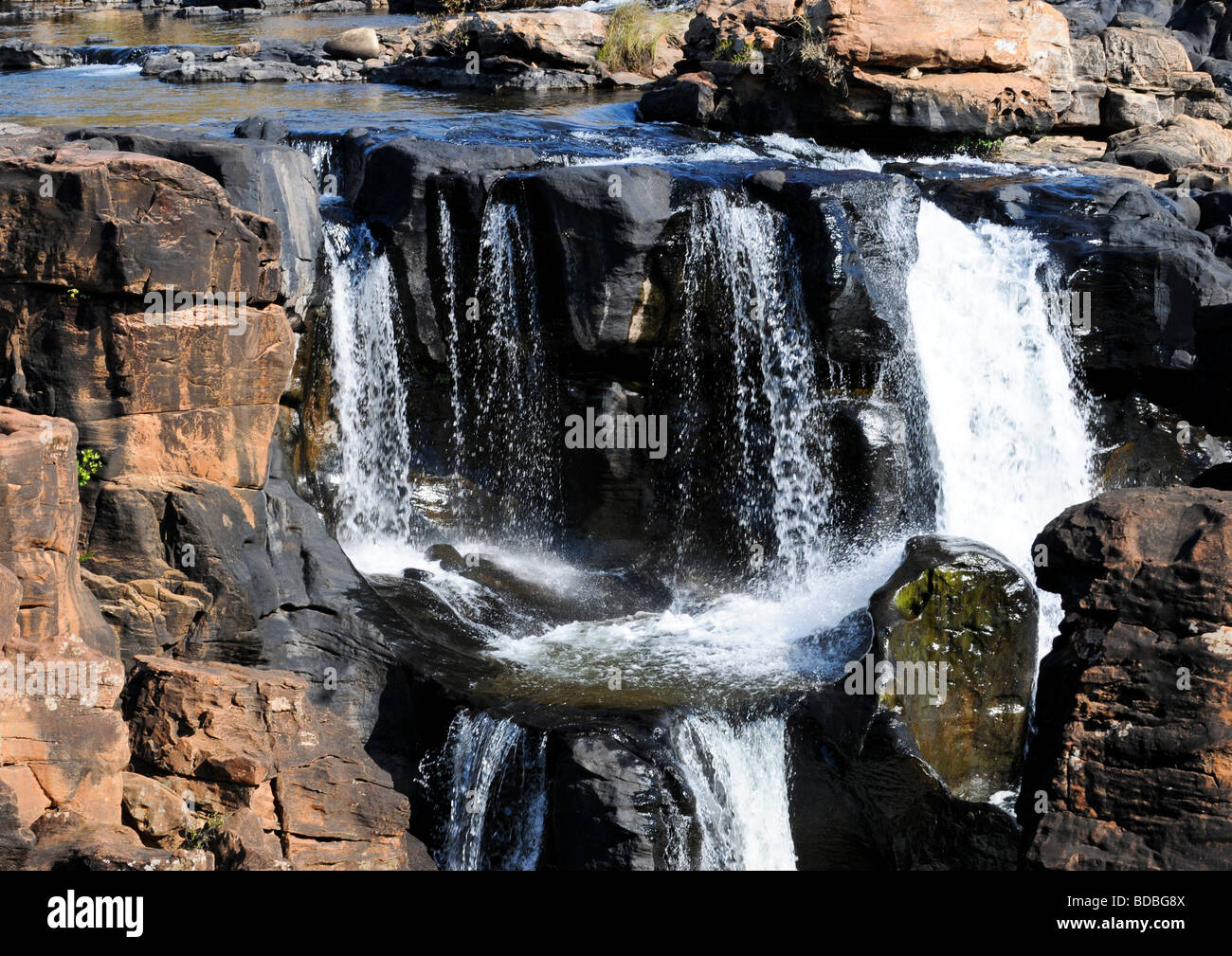 One wonder of South Africa is where water of river Blyde falls on unusual formation of colourful rocks creating - Stock Image
