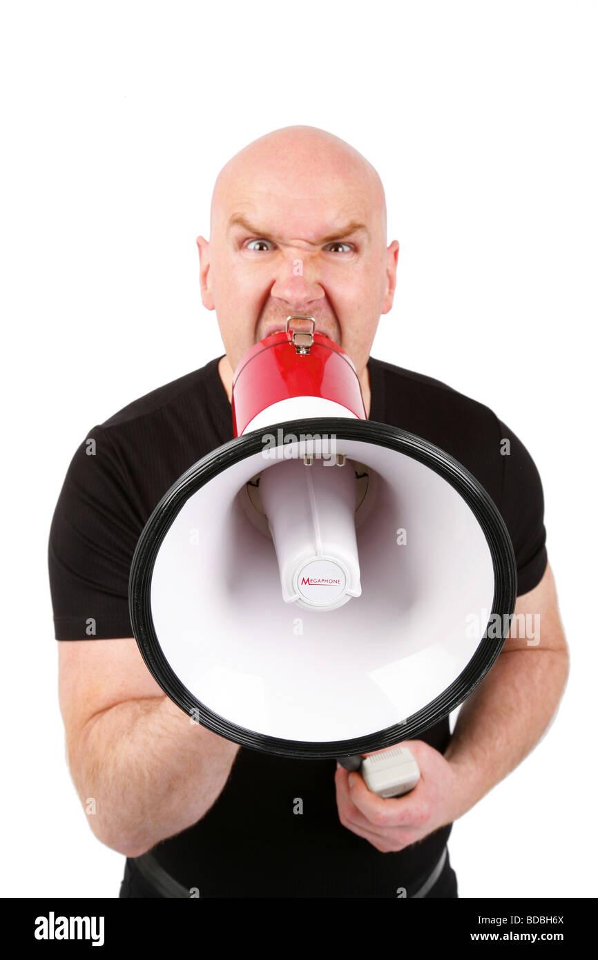 bald headed man roars in a megaphone - Stock Image