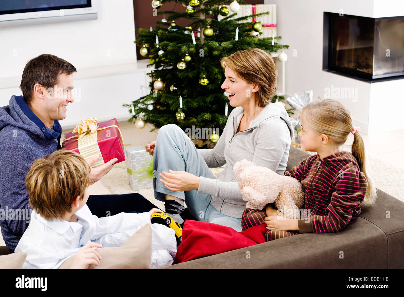 family exchanging presents on christmas morning - Stock Image