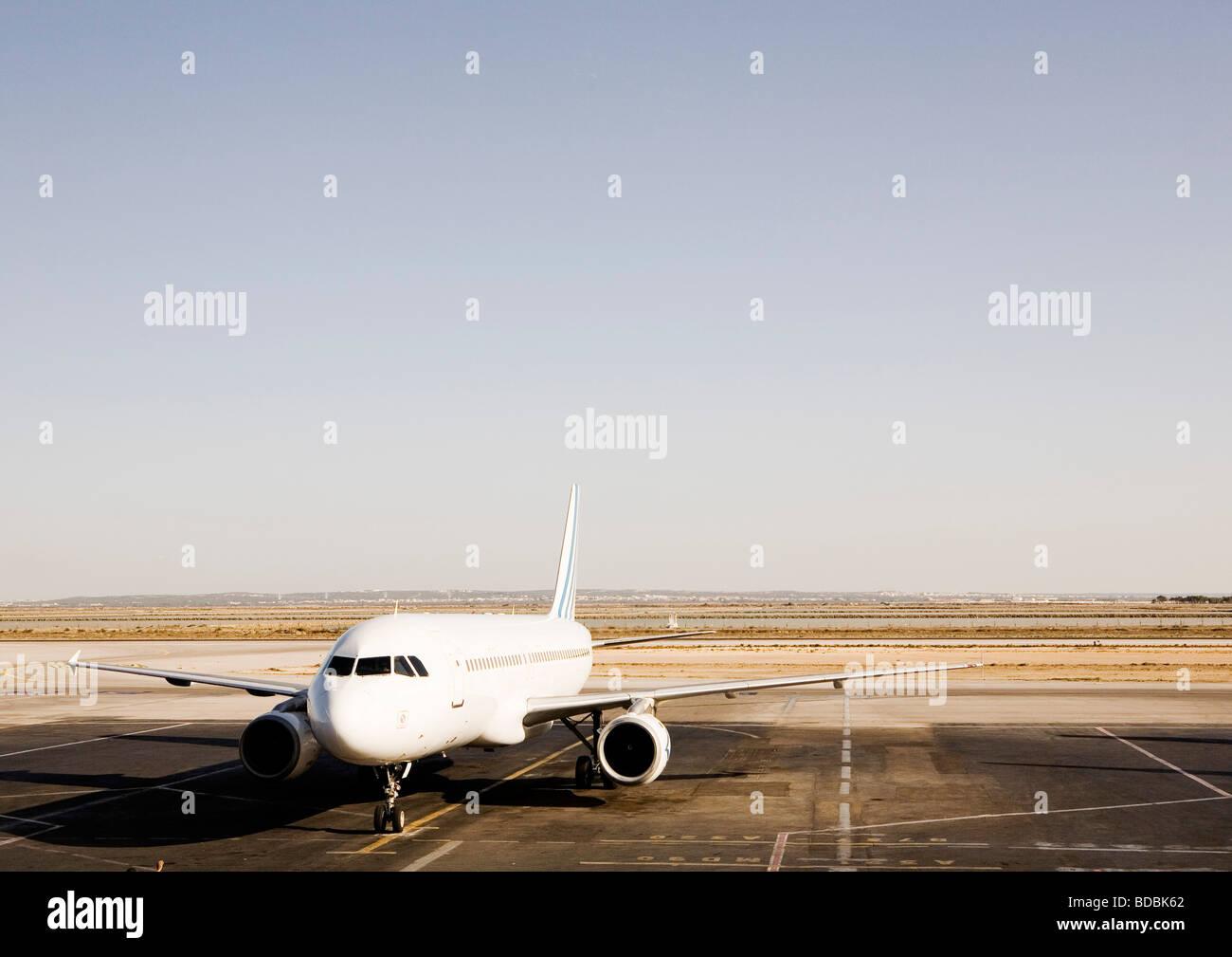 airplane on runway - Stock Image