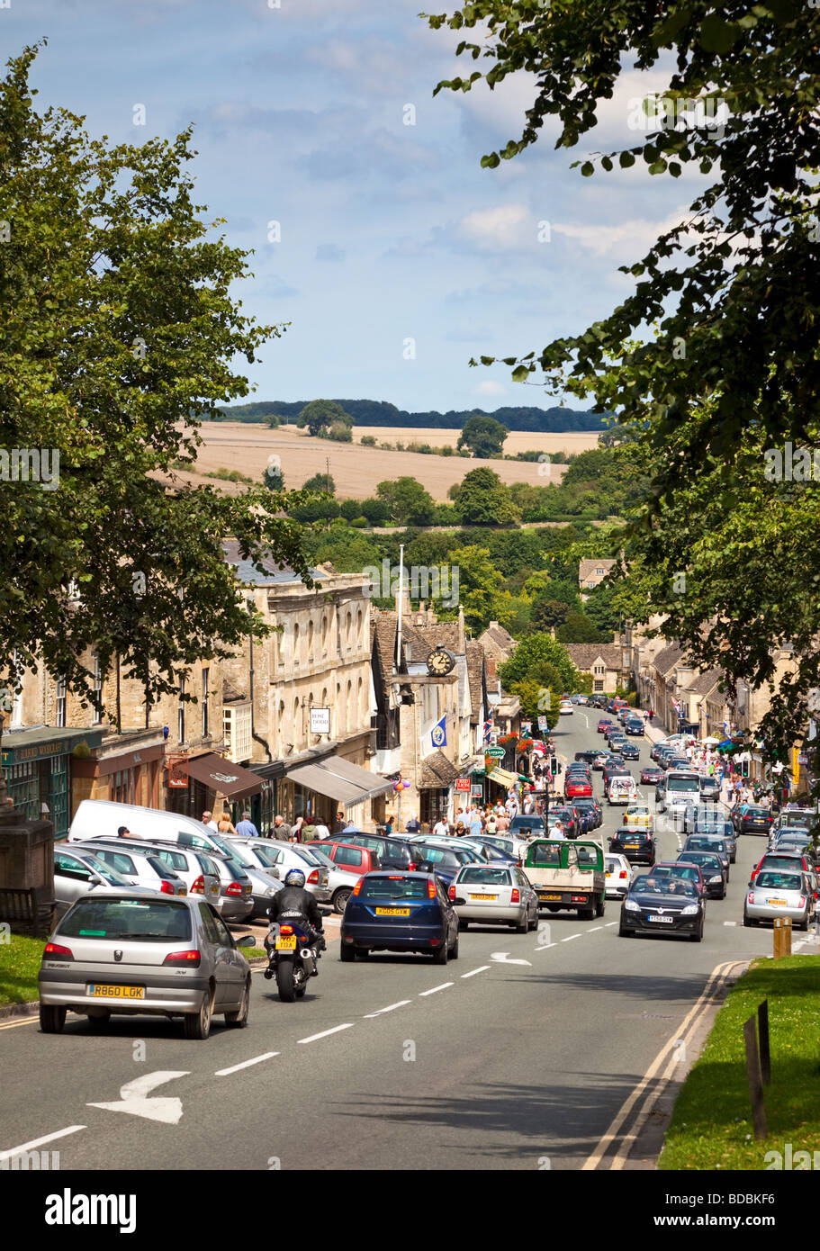 Traffic jam in the Cotswolds town of Burford, Oxfordshire, UK - in high summer - Stock Image
