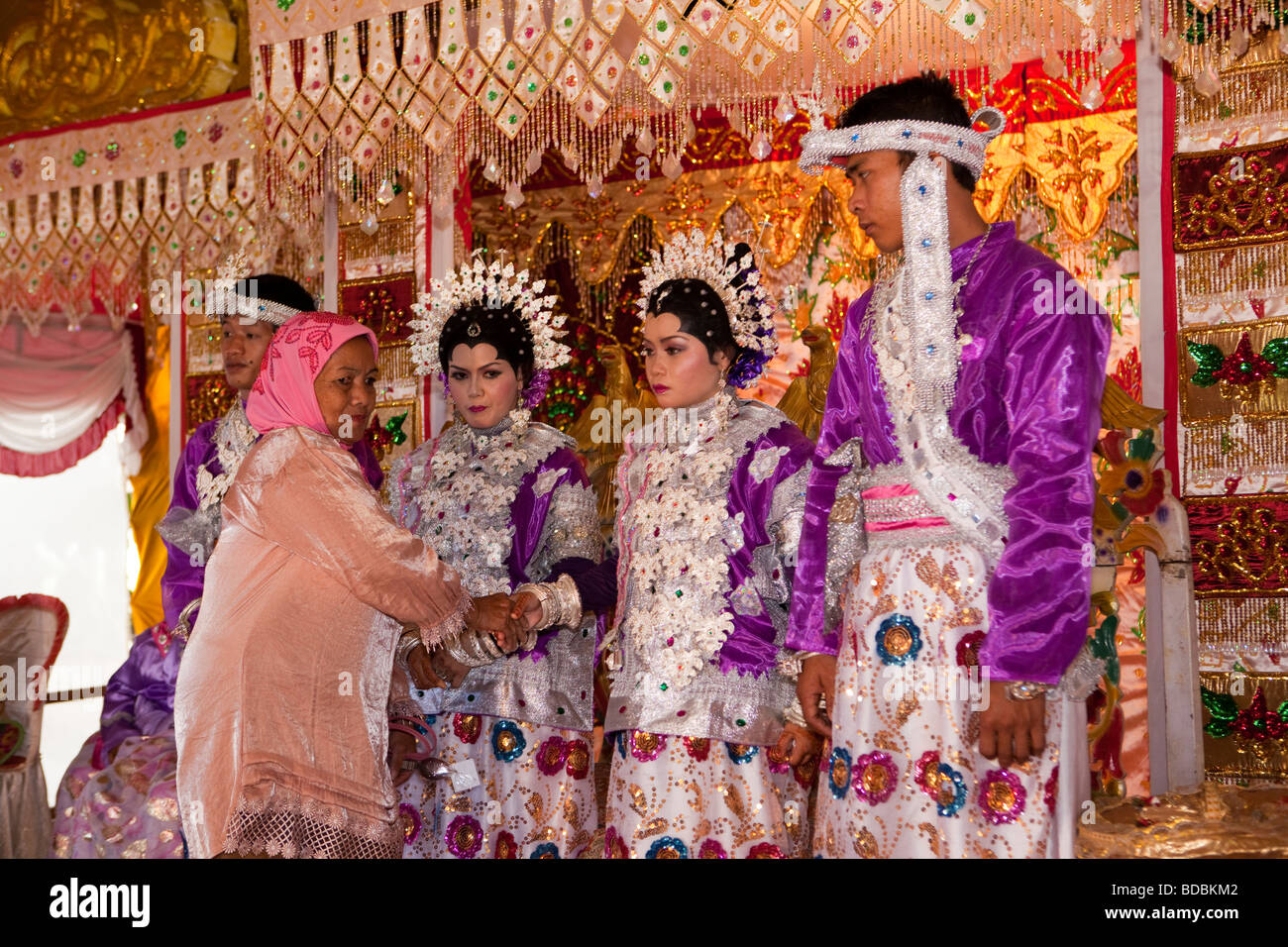 Indonesia Sulawesi Sidereng village wedding guest meeting brides at unusual double muslim marriage celebration - Stock Image
