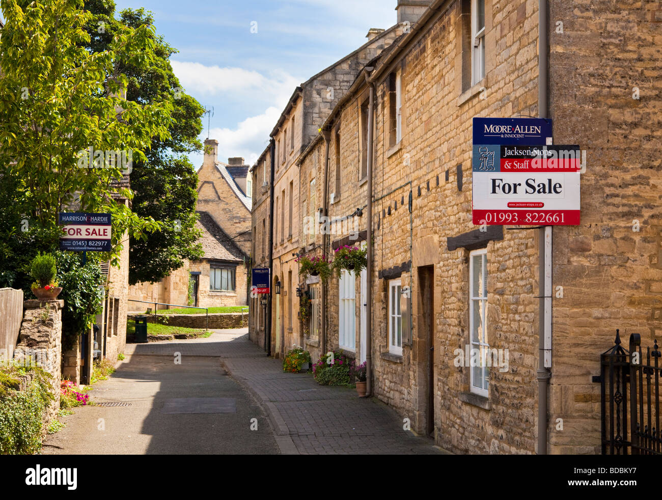House for sale sign on a village property in Northleach, Gloucestershire, UK - Stock Image
