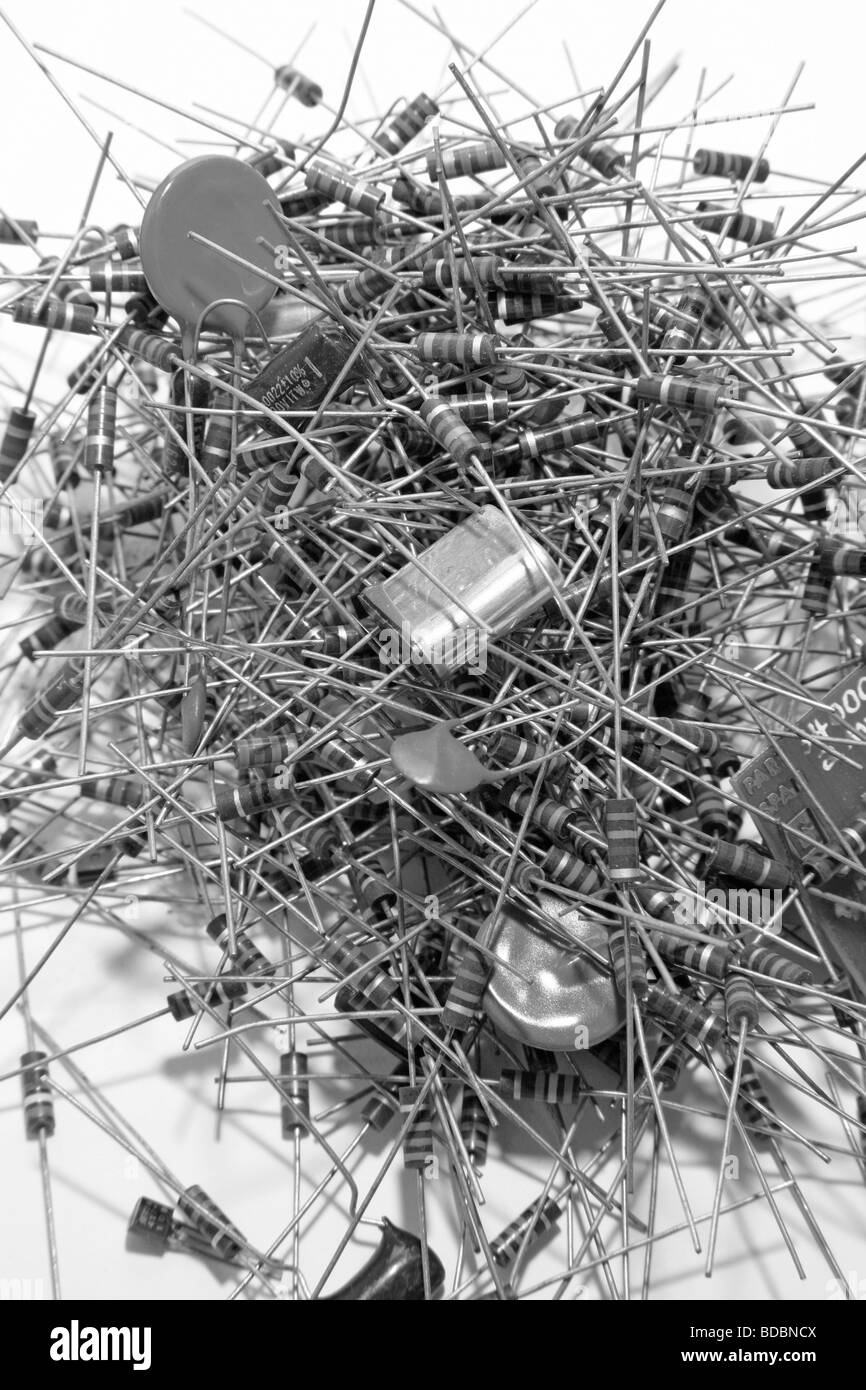 pile of old resistors capacitors and electronic components - Stock Image