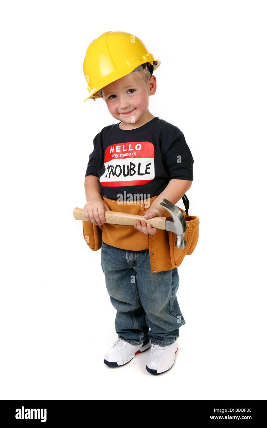 Cute Child Boy Holding Hammer Wearing Toolbelt and Hard Hat - Stock Image