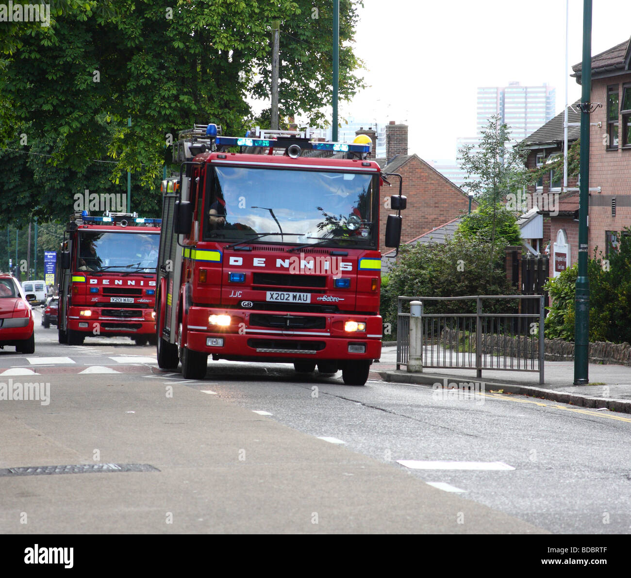 Fire engines responding to an emergency in a U.K. city. - Stock Image