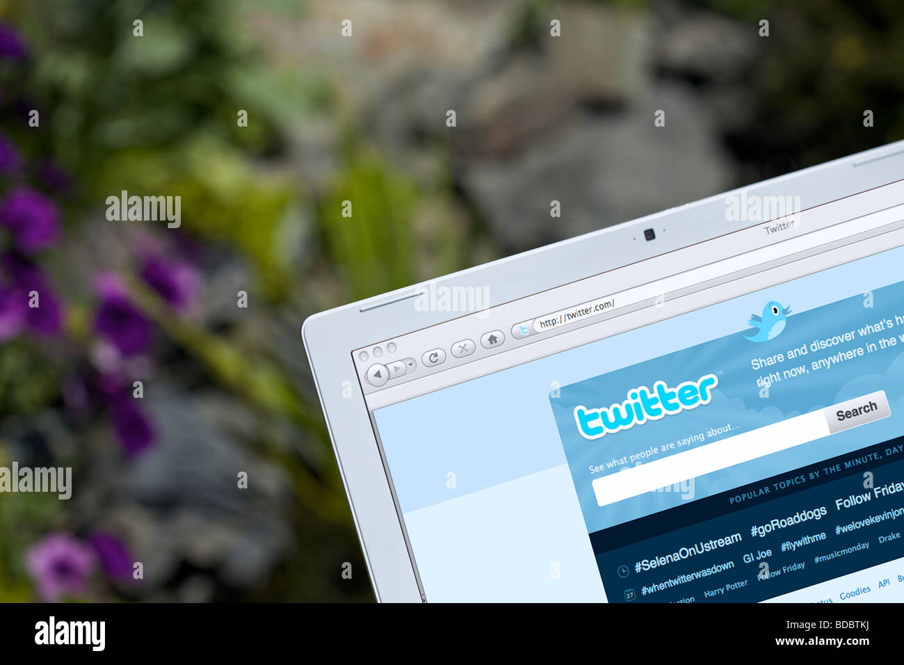 Laptop showing social networking Twitter splash screen page Stock Photo