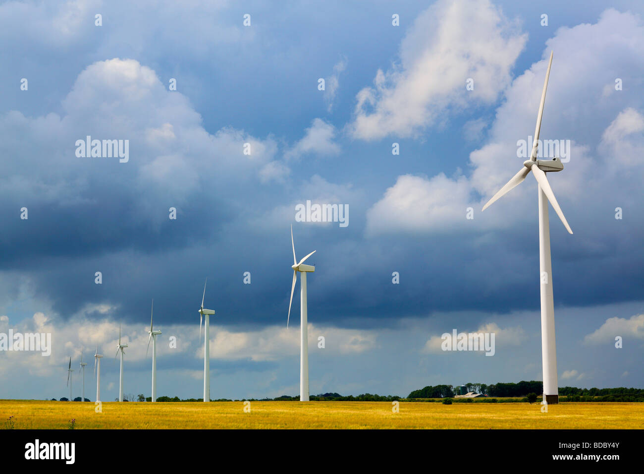 Row of wind turbines in Denmark - Stock Image