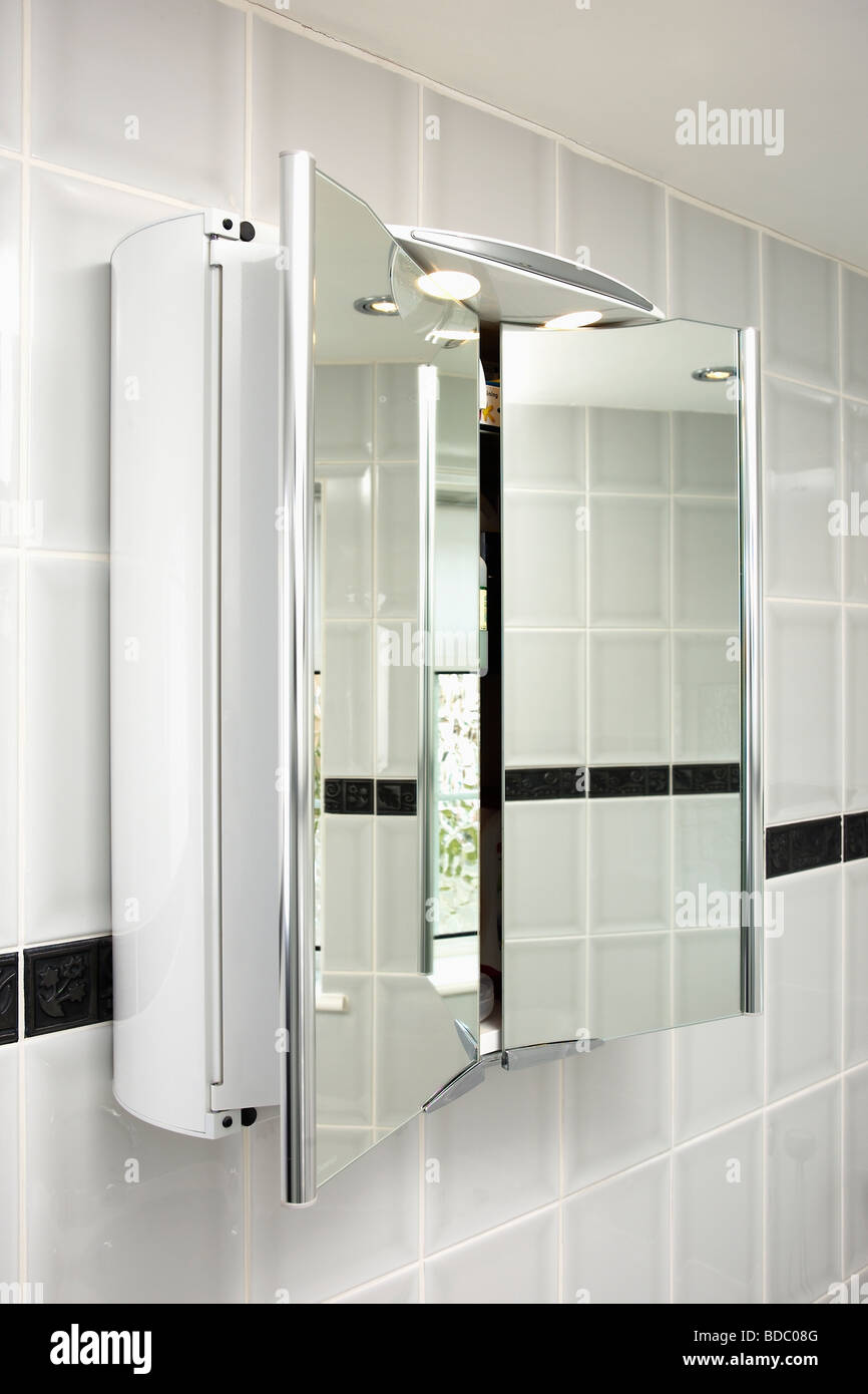 Close Up Of Mirrored Bathroom Cabinet With Doors Open Stock Photo Alamy