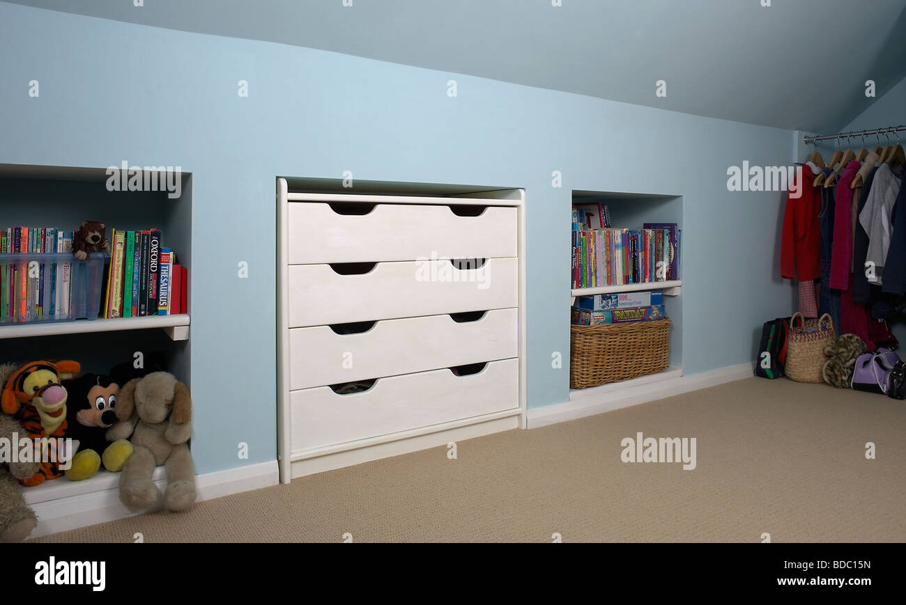White Fitted Storage Drawers And Alcove Shelves In Pastel Attic Blue Bedroom
