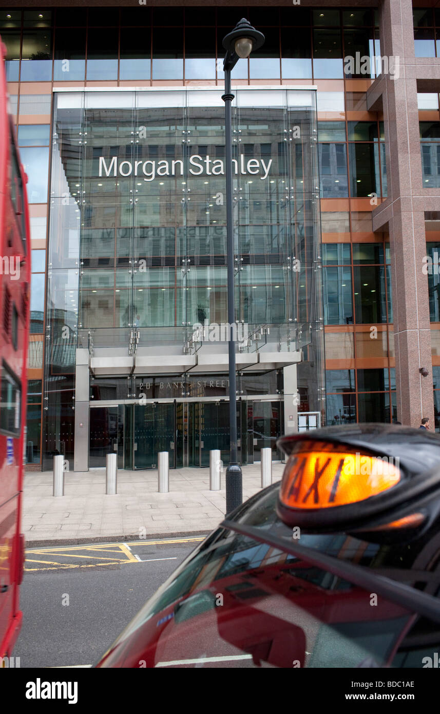 Taxi is waiting in front of Morgan Stanley Bank Headquarter in London - Stock Image