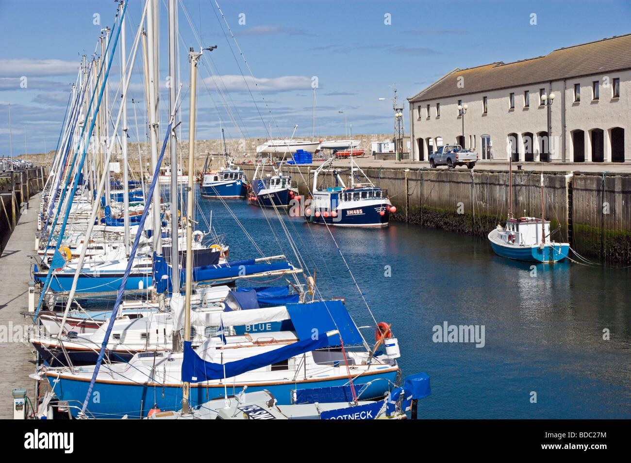 Lossiemouth harbour Moray Scotland with sailing and other pleasure boats moored. - Stock Image