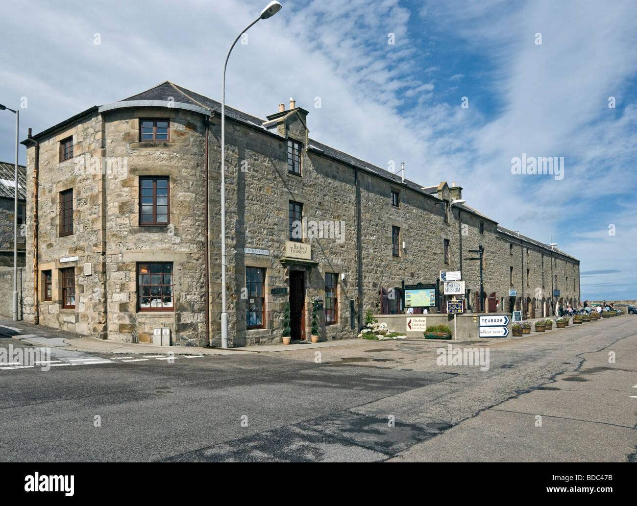 Shops and restaurant in restored building Lossiemouth Harbour Moray Scotland - Stock Image