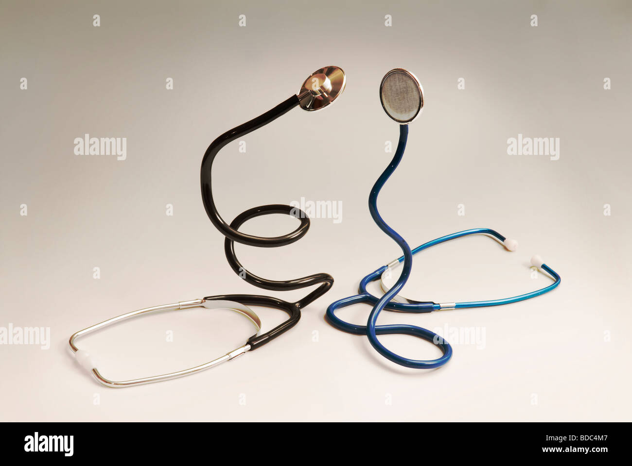 two stethoscopes coiled like snakes - Stock Image