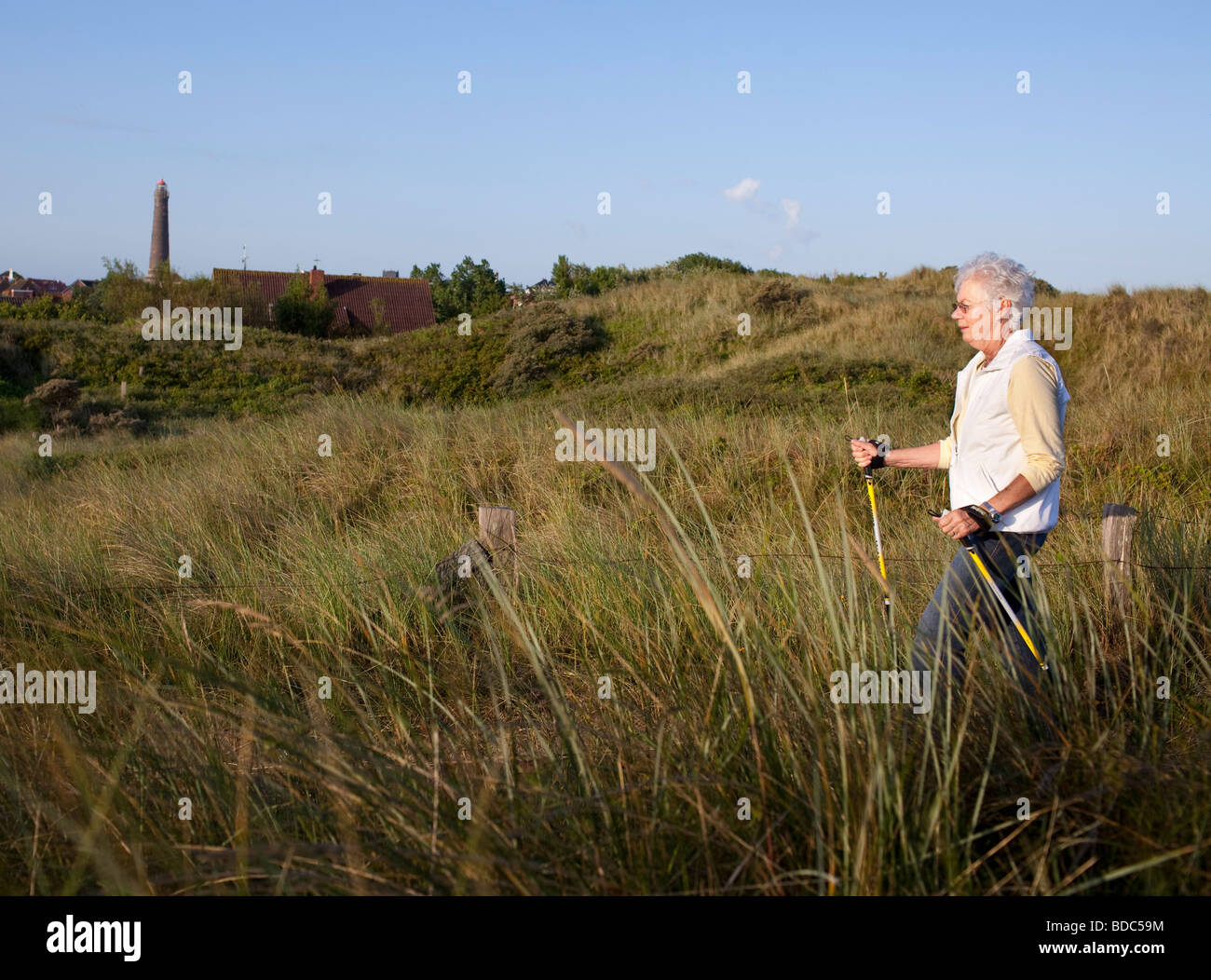Woman walking in the dunes Stock Photo