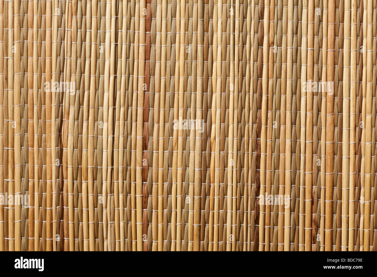 grass mat background in brown tones - Stock Image