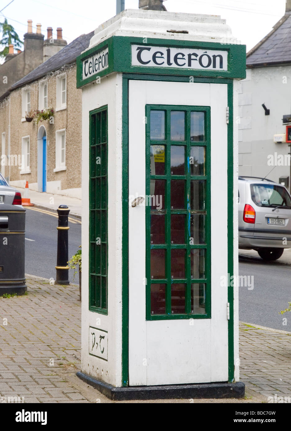 A green and white Irish telephone box, situated in the pretty village of Enniskerry, County Wicklow Ireland - Stock Image