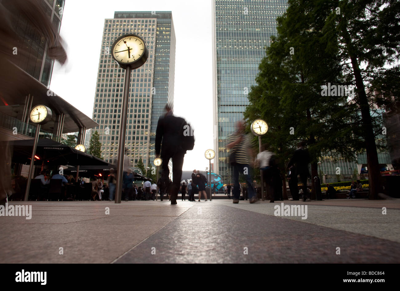 Clocks at financialdistrict Canary Wharf in London - Stock Image