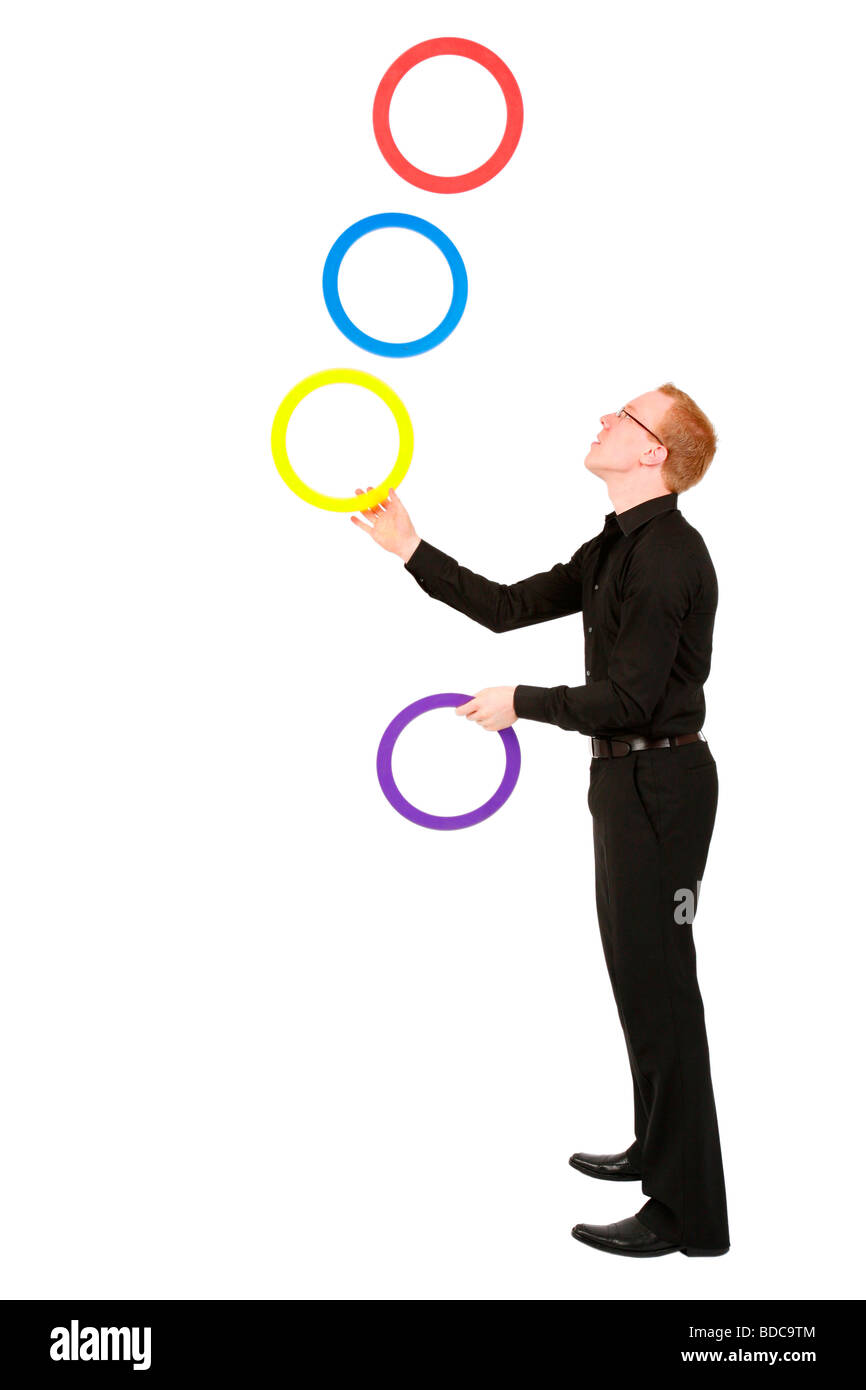 young man juggling with rings - Stock Image