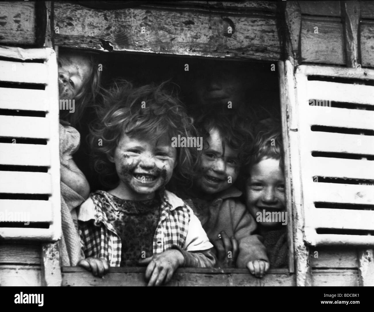 people, children, infants, little Roma children at a window, laughing, Ireland, 1968, Additional-Rights-Clearances - Stock Image