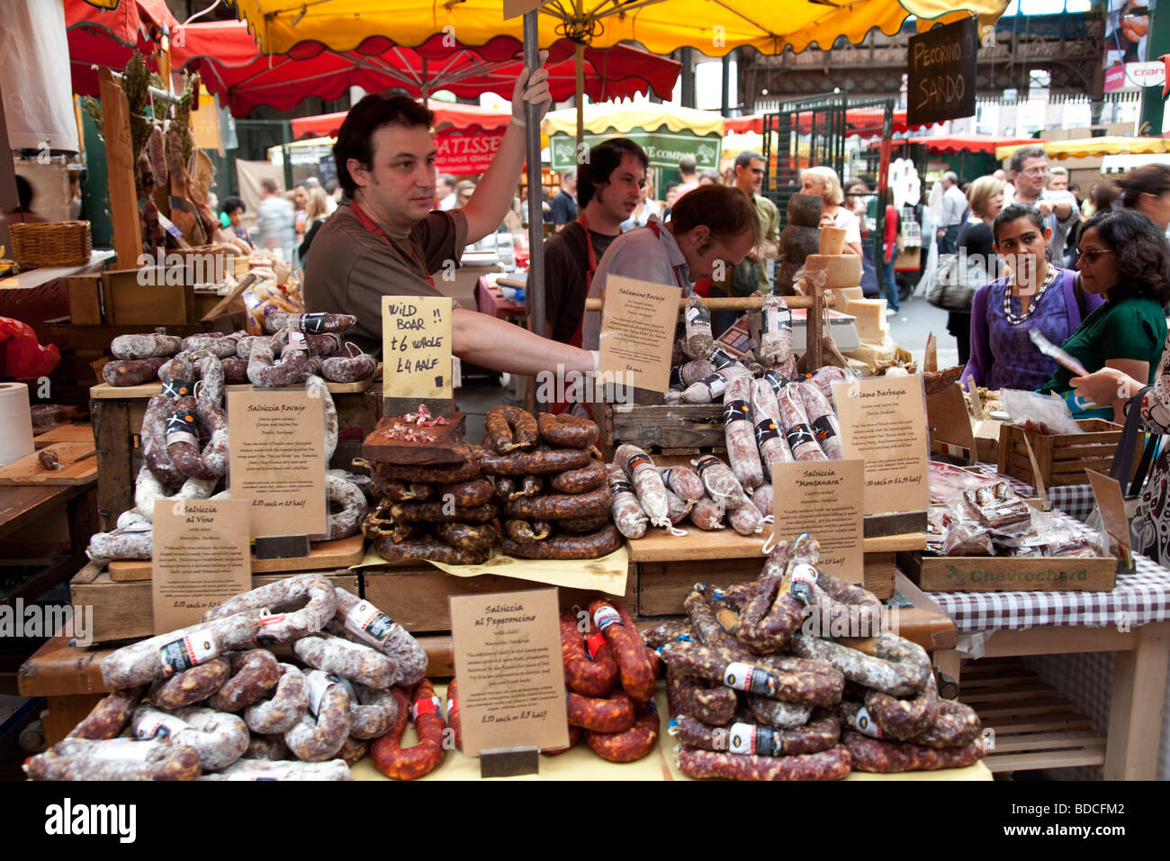 Cured meat seller at Borough Market. - Stock Image