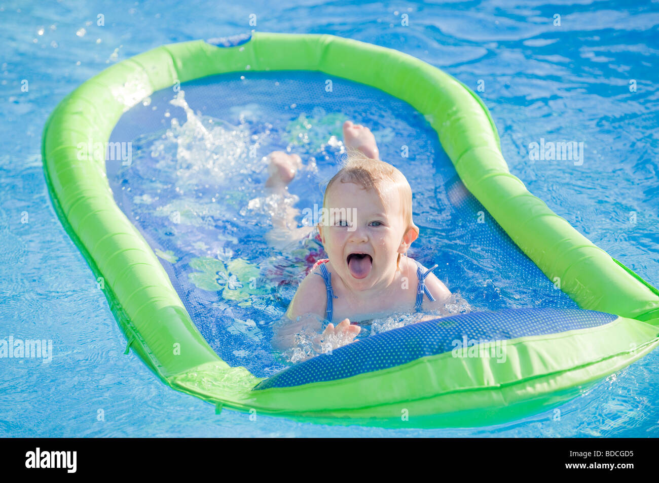 baby girl enjoying swimming in an outdoor pool with the aid of a partial BDCGD5