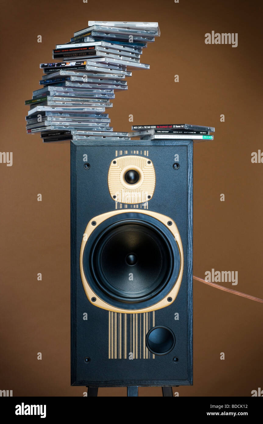 Stack of Cd s on loudspeaker - Stock Image