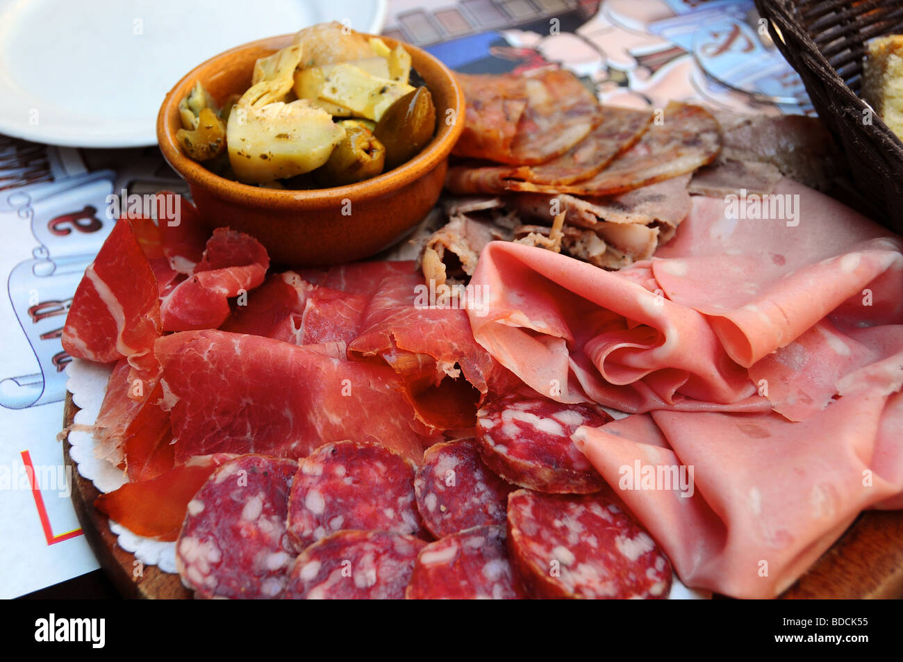 Platter of local meats served at a Tamburini delicatessan, Bologna, Italy - Stock Image