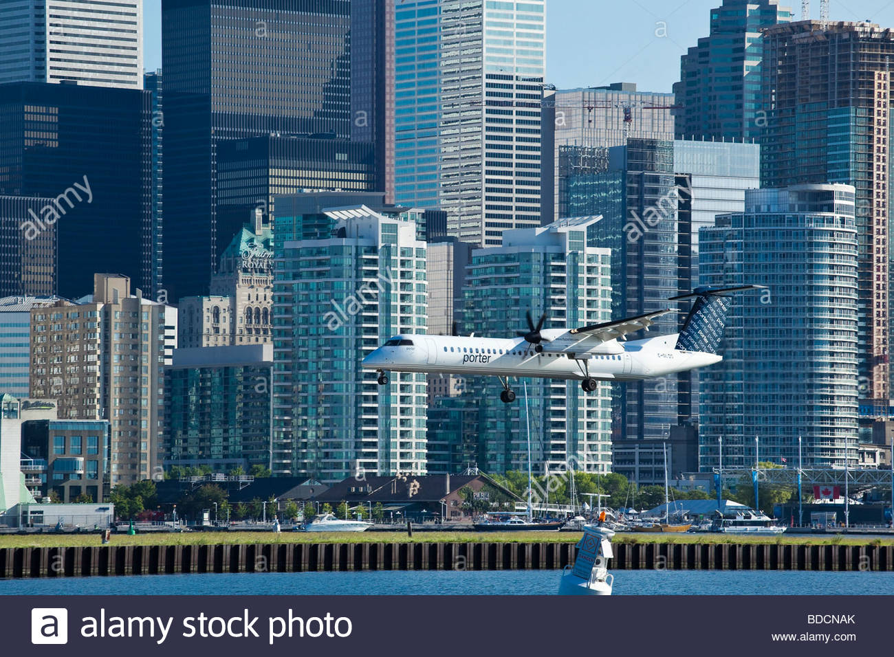 Bombardier Q400 aircraft from Porter airlines landing at Toronto City Centre Airport in Toronto Ontario Canada - Stock Image