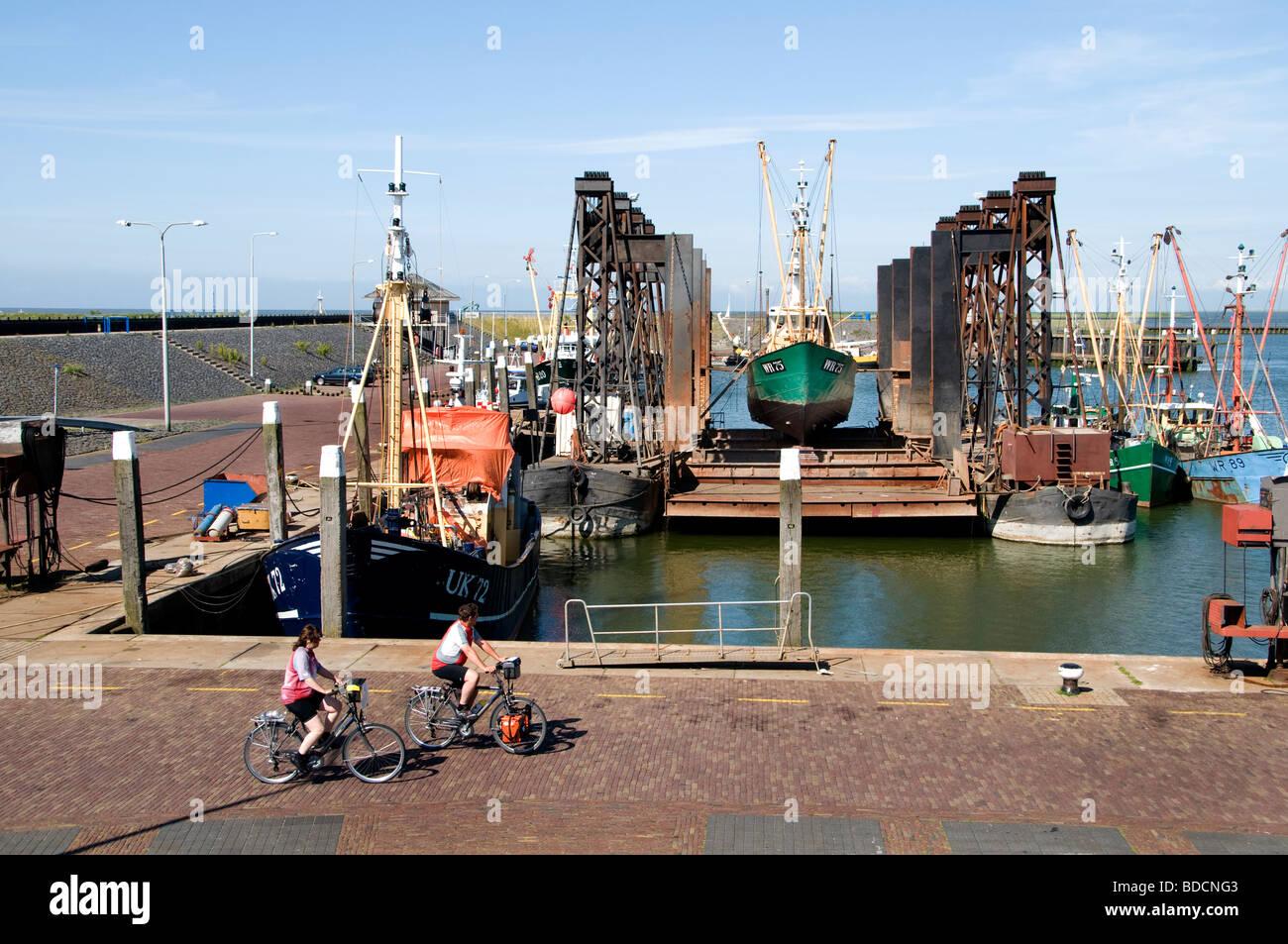 Den Oever  Netherlands fishing trawler floating dry dock shipyard port harbor Wadden Sea Waddenzee Wad - Stock Image