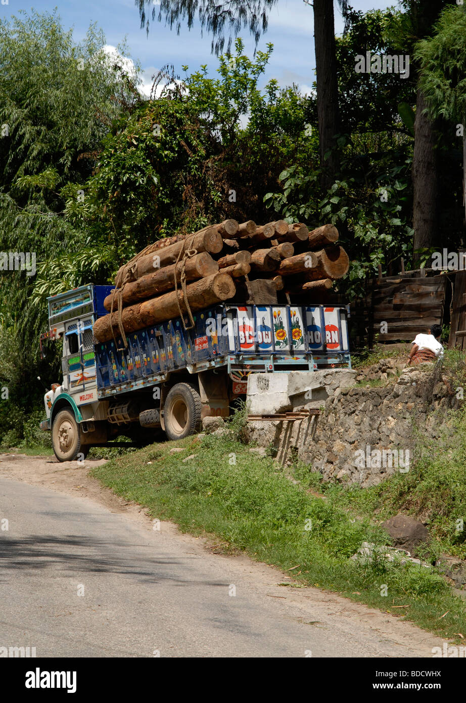 A lorry excessively loaded with trunks near Wangdue, Bhutan - Stock Image